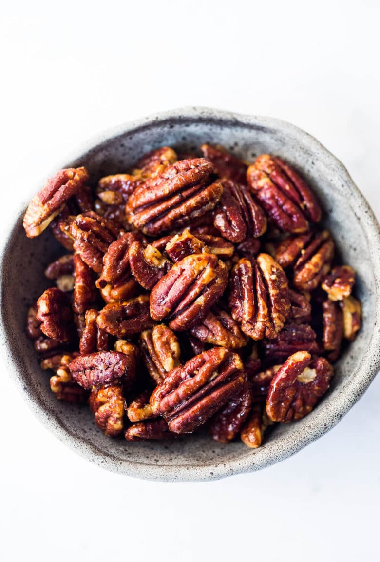 EASY Candied Pecans made in just 15 minutes in the Oven. Only 3 ingredients! Oil free, Sugar Free, Vegan and totally foolproof! The BEST recipe that comes out perfect every time! #candiedpecans #maplepecans