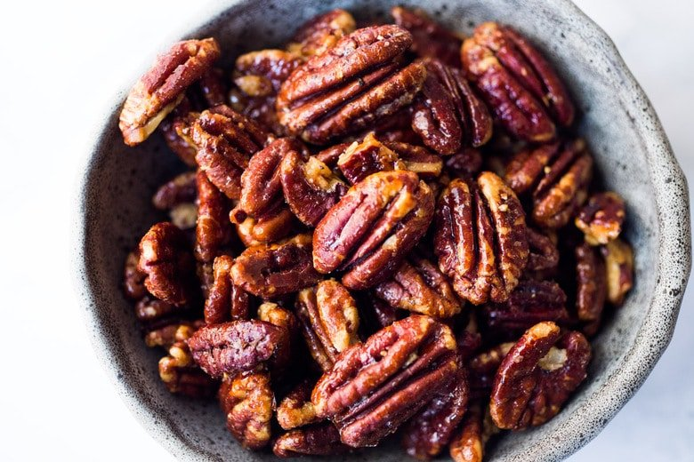 Maple-Roasted Candied Pecans made in just 15 minutes in the Oven. Only 3 ingredients! Oil free, Sugar Free, Vegan and totally foolproof! The BEST recipe that comes out perfect every time! #glazednuts #candiedpecans #maplepecans #pecans