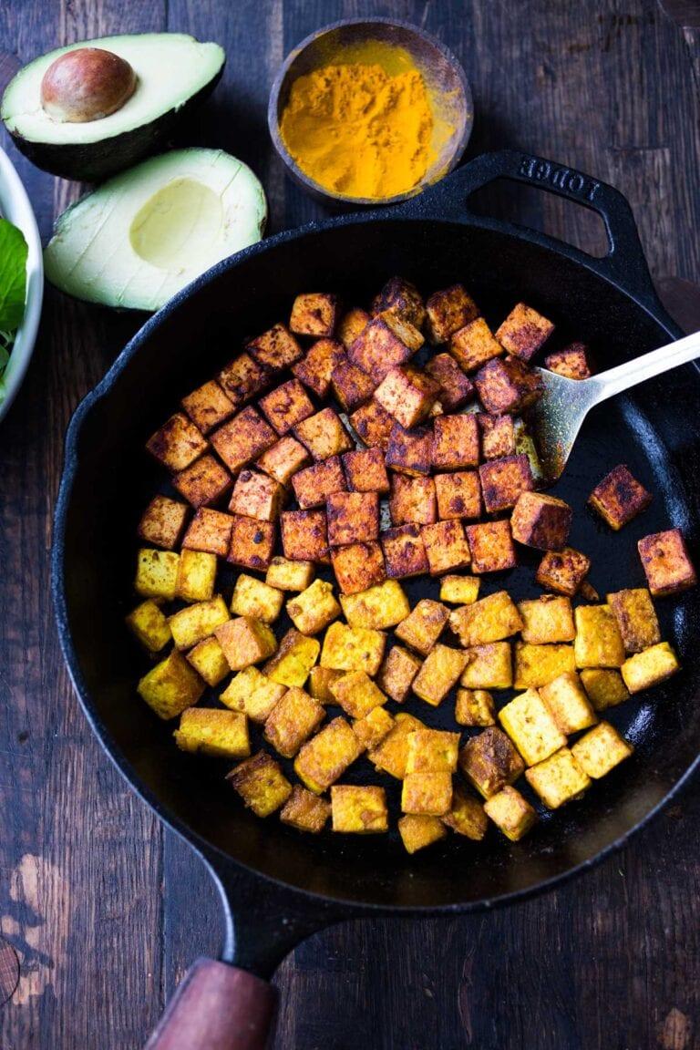 How to make flavorful Crispy Tofu on the stovetop in 20 minutes! You'll find a million uses for this crispy tofu and fun ways to season it - adding it to meals you are already making. #crispytofu #simpletofurecipes #easytofu #tofu #tofurecipes #friedtofu #stirfriedtofu