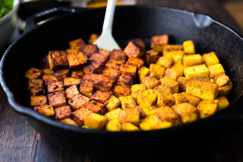 How to make flavorful Crispy Tofu on the stovetop in 20 minutes! You'll find a million uses for this crispy tofu and fun ways to season it - adding it to meals you are already making. #crispytofu #simpletofurecipes #easytofu #tofu #tofurecipes #friedtofu #stirfriedtofu