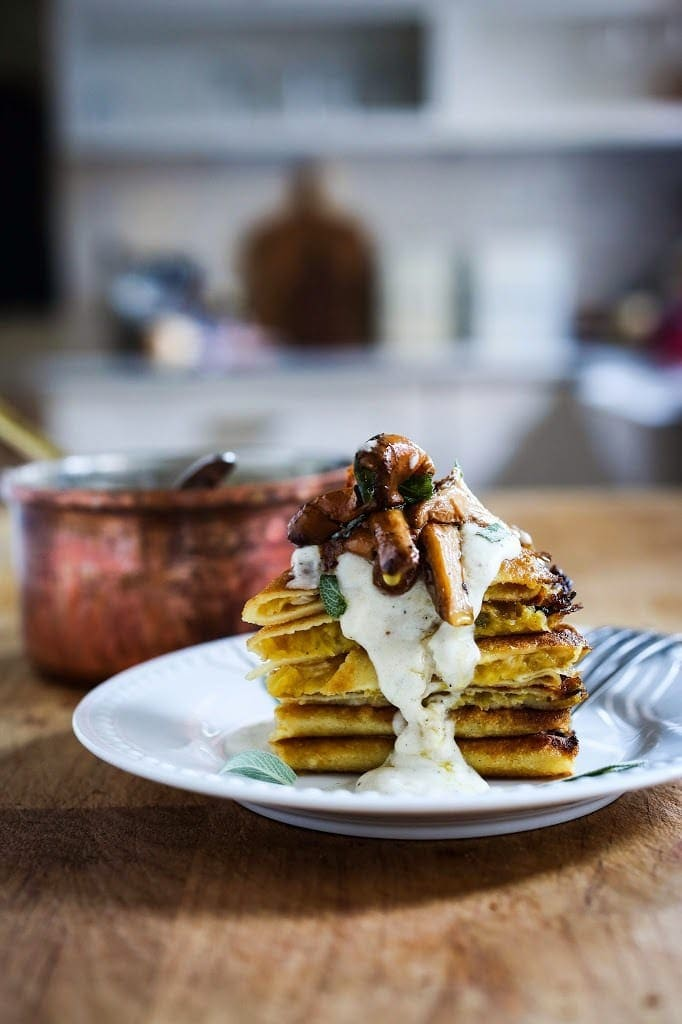 Savory Mushroom Crepes with Spaghetti Squash and Sage drizzled with Bechemal Sauce – a luxurious decadent vegetarian dinner recipe, perfect special gatherings like date night, birthdays- or even Valentine's dinner!
