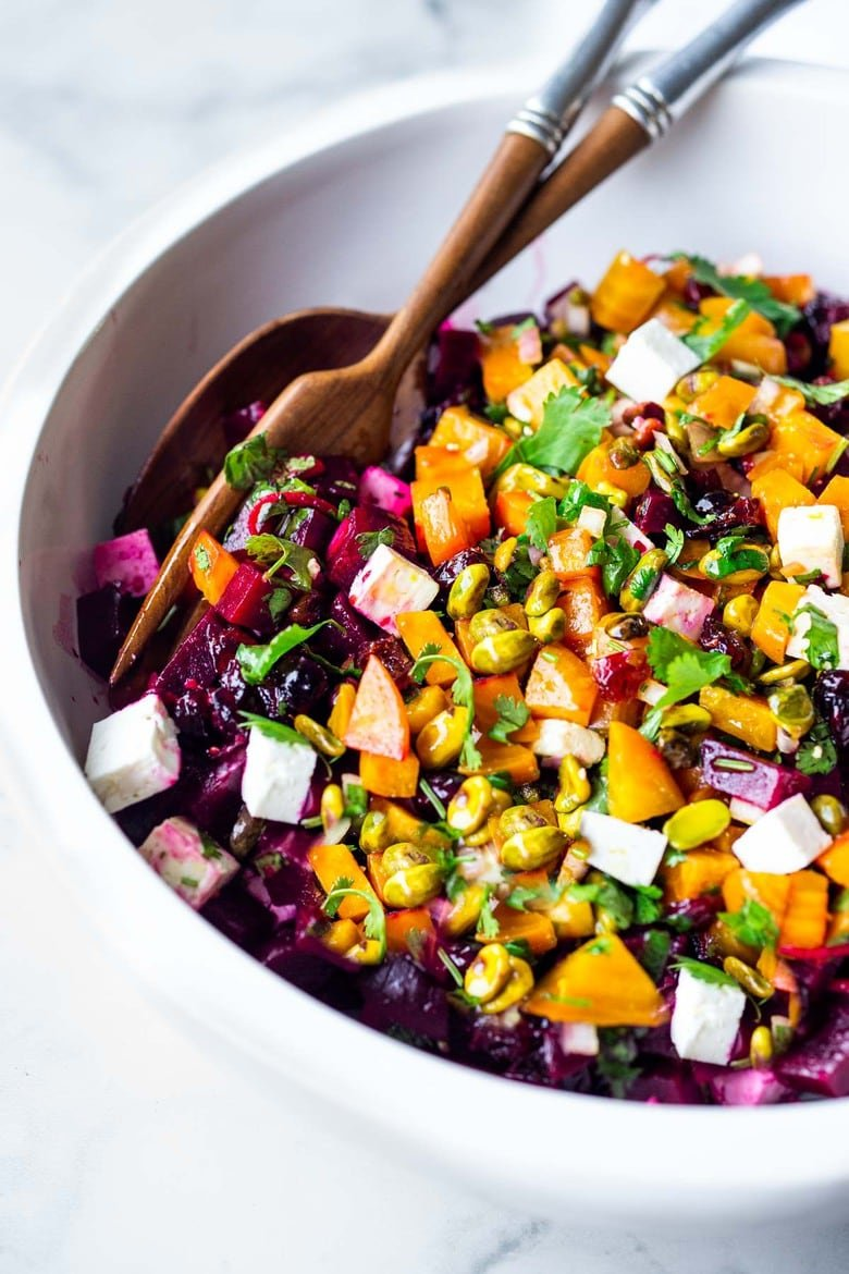 50 MUST-TRY FARMERS MARKET RECIPES! Truly one of the most beautiful and delicious Beet Salads with Pistachios, Feta, cilantro and orange in a simple citrus vinaigrette. Can be made ahead and keeps for 3 days in the fridge. #beetsalad #holidaysalad #goldenbeets #beets