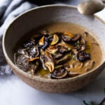 Creamy Mushroom Soup with Rosemary and Garlic - a delicious easy recipe that is Keto friendly and perfect for special gatherings or simple enough for weeknight dinners! Serve this with crusty bread for a simple hearty meal! #mushroomsoup #mushroomsouprecipe #mushroomrecipes #ketosoup