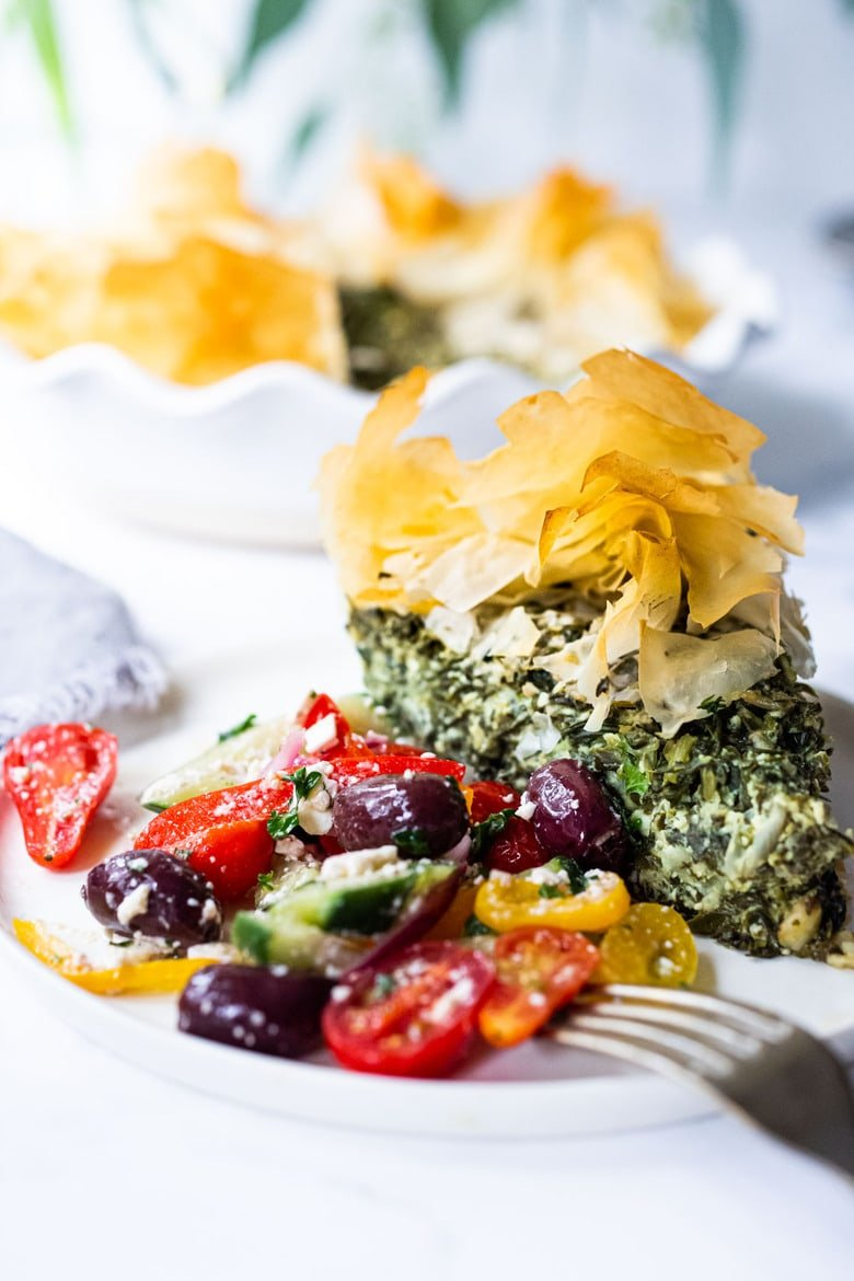 Spanakopita Pie - an easy, healthy recipe for spanakopita, with double the spinach filling, made in a pie pan! A delicious Greek-style lunch or brunch idea! Delicious served with a Simple Greek Salad! #spanakopita #spinachrecipes #phyllo #spanakopitapie #phyllodough