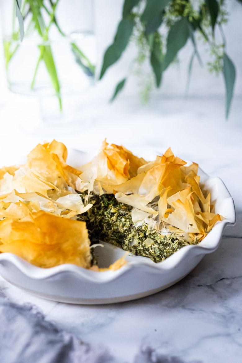 Spanakopita Pie - an easy, authentic, healthy recipe for Greek spanakopita, made in a pie pan! #spanakopita #spinachrecipes #phyllo #spanakopitapie #phyllodough