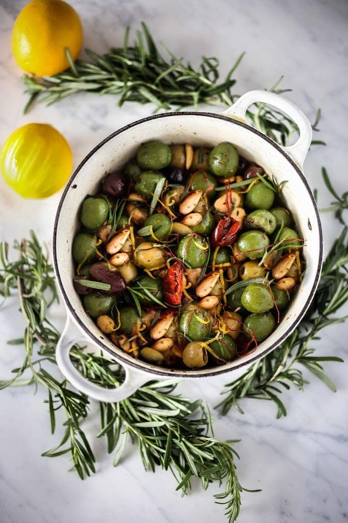Warm olives with rosemary, garlic, and almonds - a simple, delicious appetizer that is full of amazing flavor, that can be made very quickly and easily!#warmolives #olives #marcona #almonds #rosemaryolives