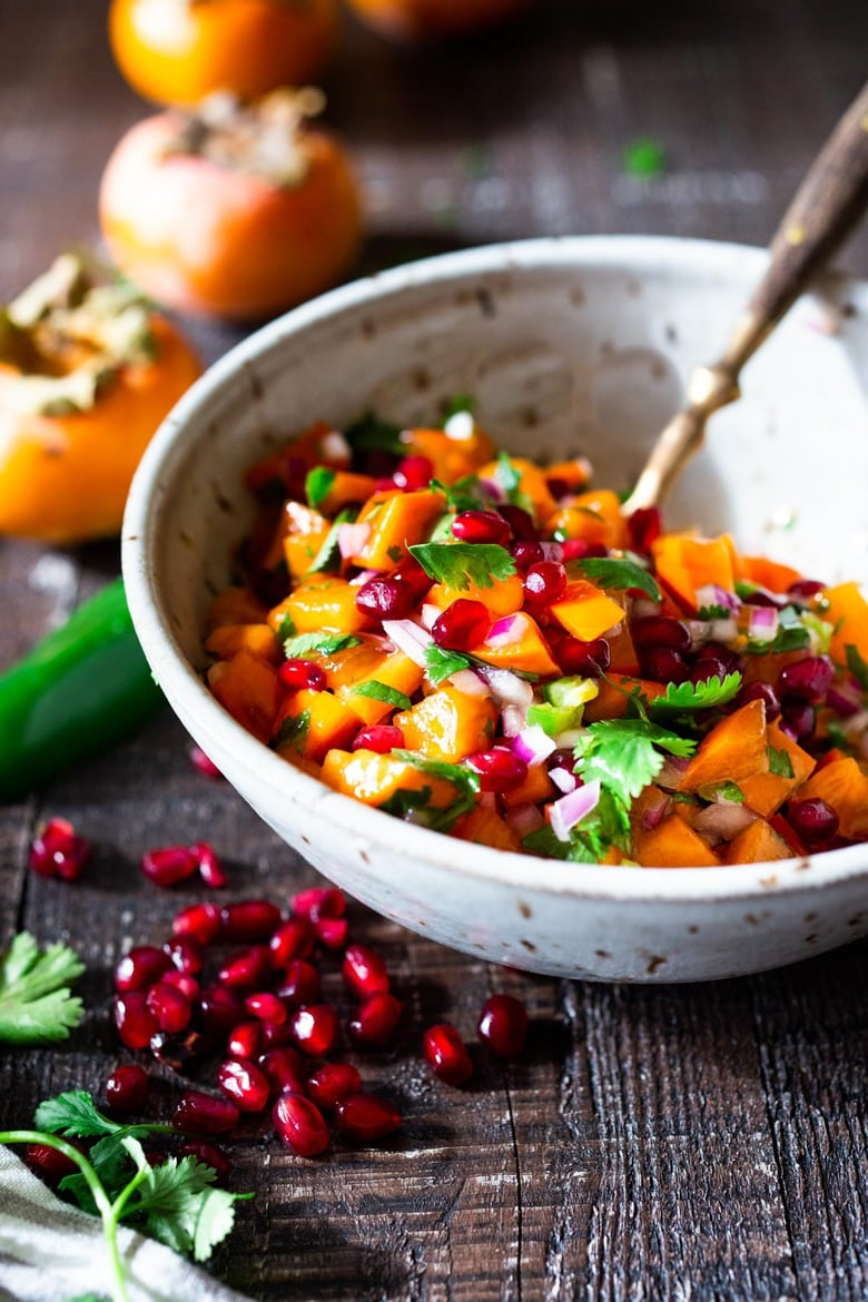 How to make the most delicious Persimmon Salsa in winter, using Fuyu Persimmons instead of tomatoes! Easy, quick and flavorful! Use this on fish tacos or like you would Pico de Gallo. #salsa #persimmons #persimmonrecipes #picodegallo
