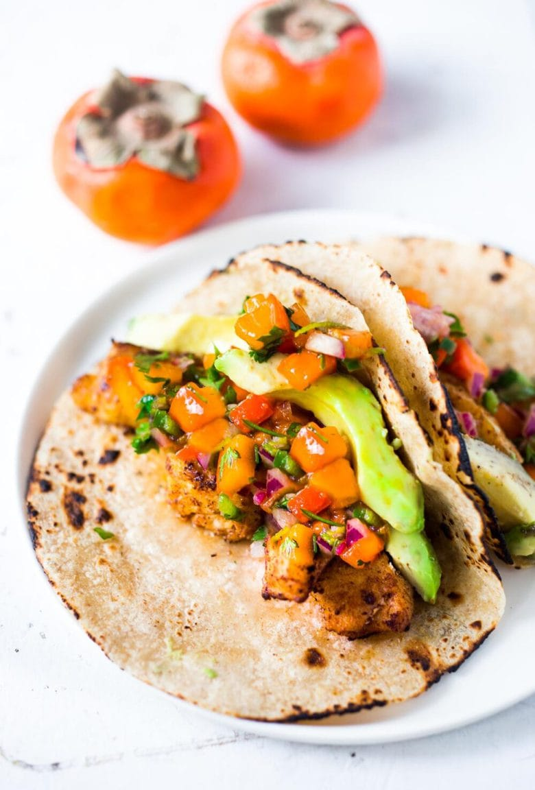 Fish Tacos with Persimmon Tacos -How to make the most delicious salsa in winter, using Fuyu Persimmons instead of tomatoes! Easy, quick and flavorful! Use this on fish tacos or like you would Pico de Gallo. #salsa #persimmons #persimmonrecipes #picodegallo
