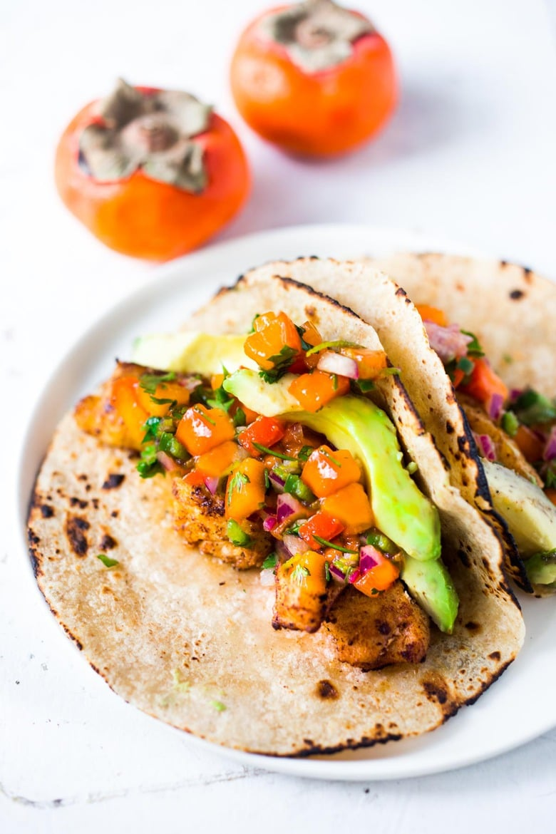 Fish Tacos with Persimmon Salsa -How to make the most delicious salsa in winter, using Fuyu Persimmons instead of tomatoes! Easy, quick and flavorful! Use this on fish tacos or like you would Pico de Gallo. #salsa #persimmons #persimmonrecipes #picodegallo