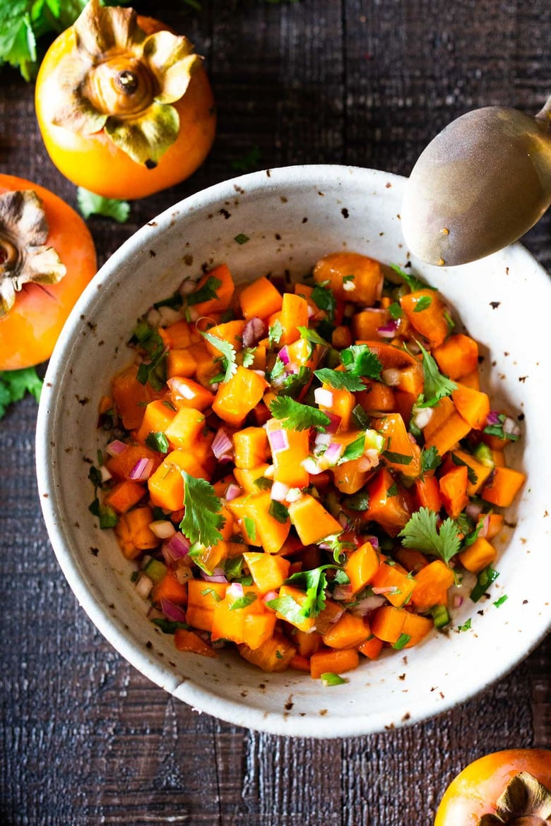 Persimmon Salsa Recipe! How to make the most delicious salsa in winter, using Fuyu Persimmons instead of tomatoes! Easy, quick and flavorful! Use this on fish tacos or like you would Pico de Gallo. #salsa #persimmons #persimmonrecipes #picodegallo