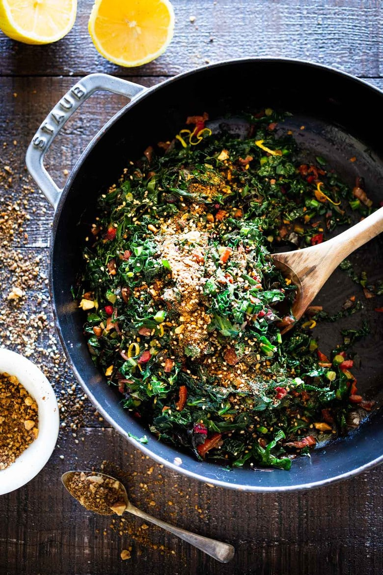 Sautéed kale and chard with garlic, shallots and lemon - a simple side dish that is vegan, low carb, Keto and full of healthy nutrients! Delicious flavor and can be made in 20 minutes! #sautéedkale #sautéedgreens, #wiltedkale, #ketosidedish, #vegansidedish