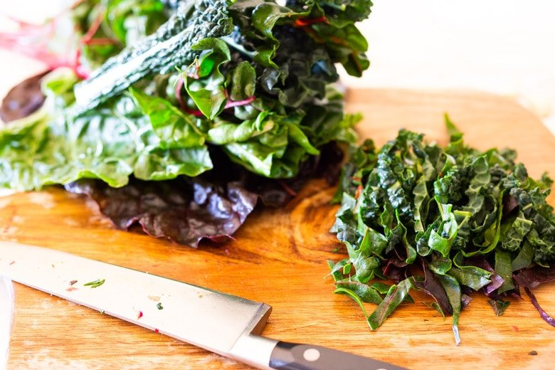 Sautéed kale and chard with garlic, shallots and lemon - a simple side dish that is vegan, low carb, Keto and full of healthy nutrients! Delicious flavor and can be made in 20 minutes! #sautéedkale #sautéedgreens, #wiltedkale, #ketosidedish, #vegansidedish,