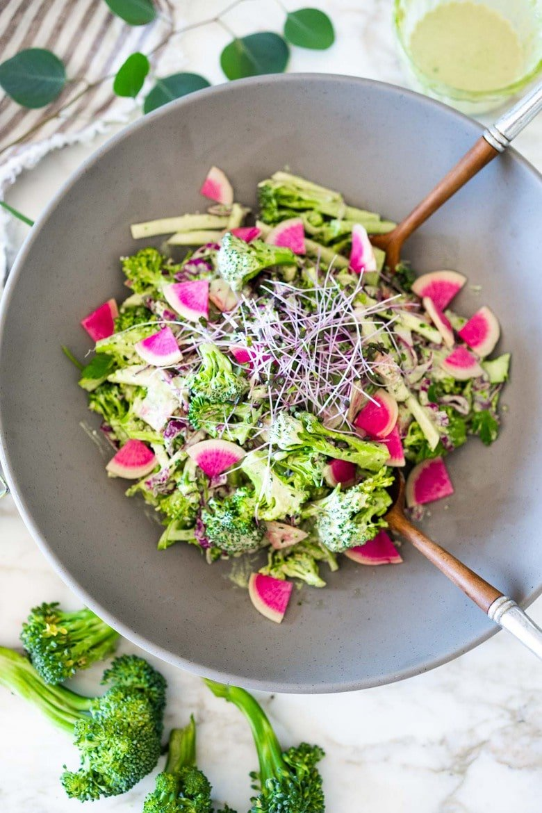 This Creamy Vegan Broccoli Salad is so good, you won't even realize it is vegan! Tossed in a creamy Hemp Dressing- it is easy, healthy and full of flavor! Vegan and Keto! #hempdressing #hemp #broccolisalad #keto #vegansalad #ketosalad