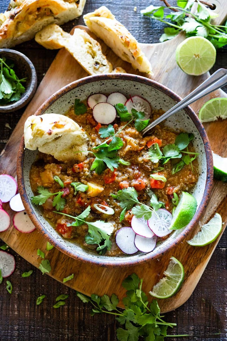 25 Tasty Lentil Recipes ! | This hearty nourishing Moroccan Red Lentil Quinoa Soup is vegan, easy to make and made with simple everyday ingredients. Flavorful and aromatic, the warming spices are especialluy cozy. This can be made in under 30 minutes in an Instant Pot or on the stovetop and keeps well for midweek meals. #vegansoup #redlentisoup #quinoasoup #moroccansoup #moroccanstew #veganstew #instantpotsoup #instantpot