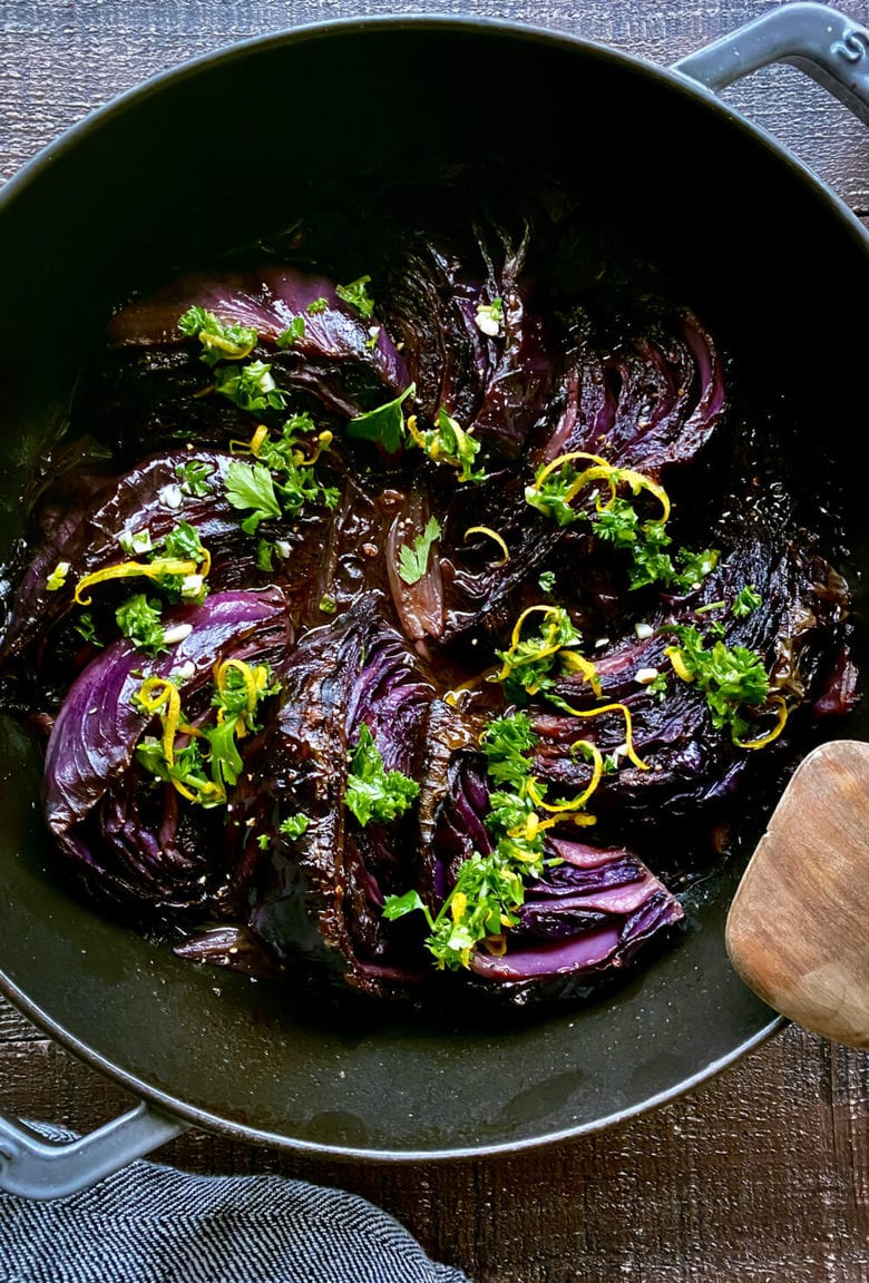 Melted Slow Braised Cabbage - slow cooked in the oven until meltingly tender, topped with Gremolata. Vegan and Gluten-free. #cabbage #braisedcabbage