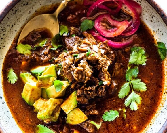 An authentic recipe for Birria, a flavorful Mexican Stew made with beef, lamb or goat that can be made in an Instant Pot, Dutch Oven or Slow Cooker. Serve this in a big bowl or make Birria Tacos - the best! #birria #birriatacos #mexicanstew #tacos