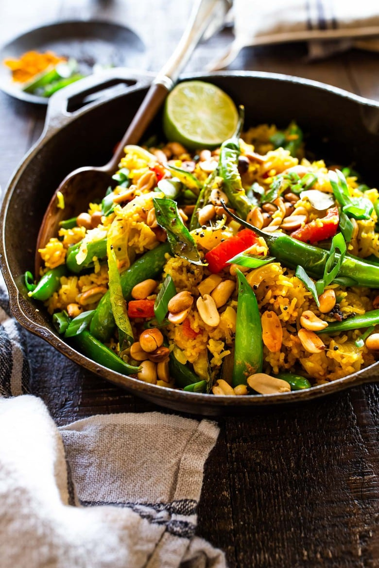 20 Vegetarian Recipes! This fragrant, turmeric-infused, Indian Fried Rice is full of healthy veggies and can be made in under 30 minutes. Vegetarian, Gluten-free and Vegan adaptable, it is a fast and easy weeknight meal- great for using up leftover rice and veggies in the fridge.