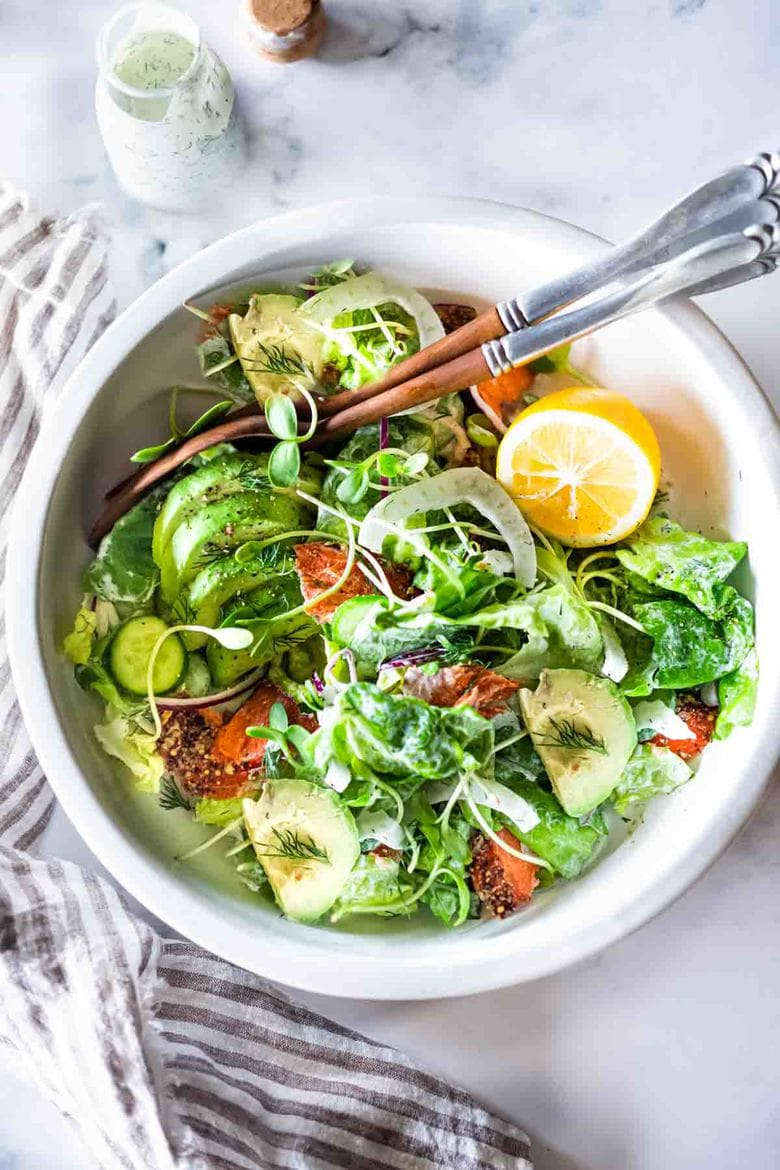 Smoked Salmon, Avocado and Fennel Salad with butter lettuce and creamy Dill Dressing. Fast and easy, this hearty entree salad makes for a delicious lunch or dinner main.#salad #salmonsalad