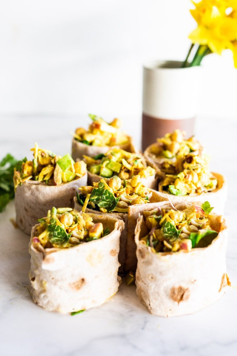Vegan Curry Chickpea Wrap -A simple vegan recipe for Curry Chickpea Salad, wrapped up with spinach and sprouts. A healthy vegan lunch idea! #veganwrap #currychickpeawrap