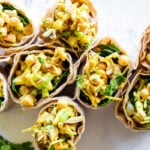 Vegan Curry Chickpea Salad Wrap with cashews, coconut, dates and celery.