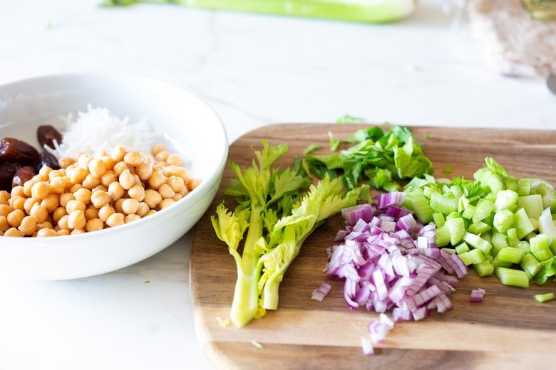 A simple vegan recipe for Curry Chickpea Salad, that can be turned into a wrap with spinach and sprouts. A healthy vegan lunch idea! #veganwrap #currychickpeawrap