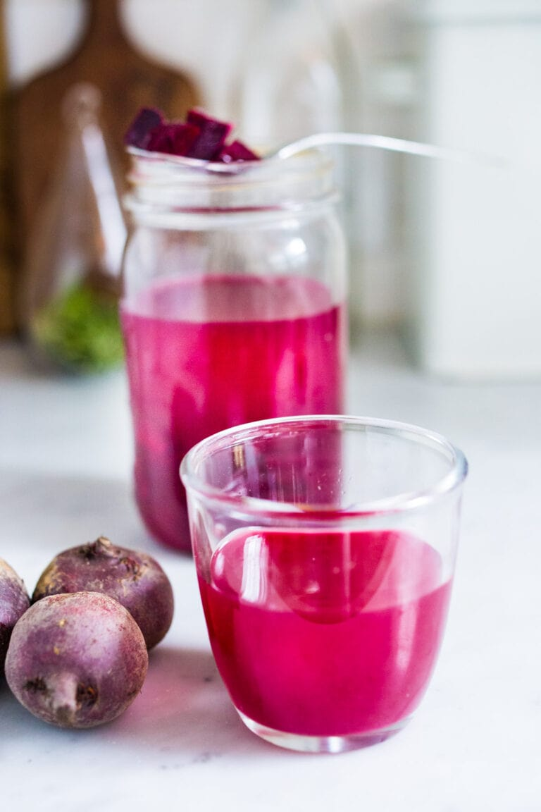 How to Make Beet Kvass! A sparkly Ukrainian probiotic drink made with beets, sea salt and water. Full of healthy probiotics from the Lacto-fermentation, Beet Kvass is believed to help boost immunity.  It tastes slightly sweet, tangy, earthy and salty- but in a good way! With just 10 minutes of hands-on time,it is so simple- just let mother nature take its course.  (Allow 2 weeks for fermentation- see notes for speeding up this process.)