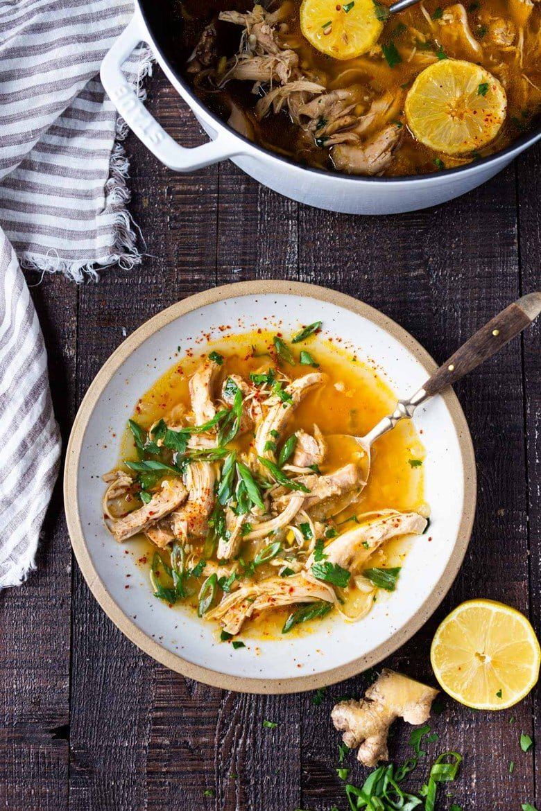 Feel Better Chicken Soup with Lemon and Ginger will warm you to your bones! Brothy and flavorful, this highly-adaptable recipe is the perfect base for your own creations- use whatever grain or starch you prefer- noodles, rice quinoa, beans- or keep it keto and low-carb! Can also be made in an Instant Pot or Slow cooker! #chickensoup #ketosoup #broth