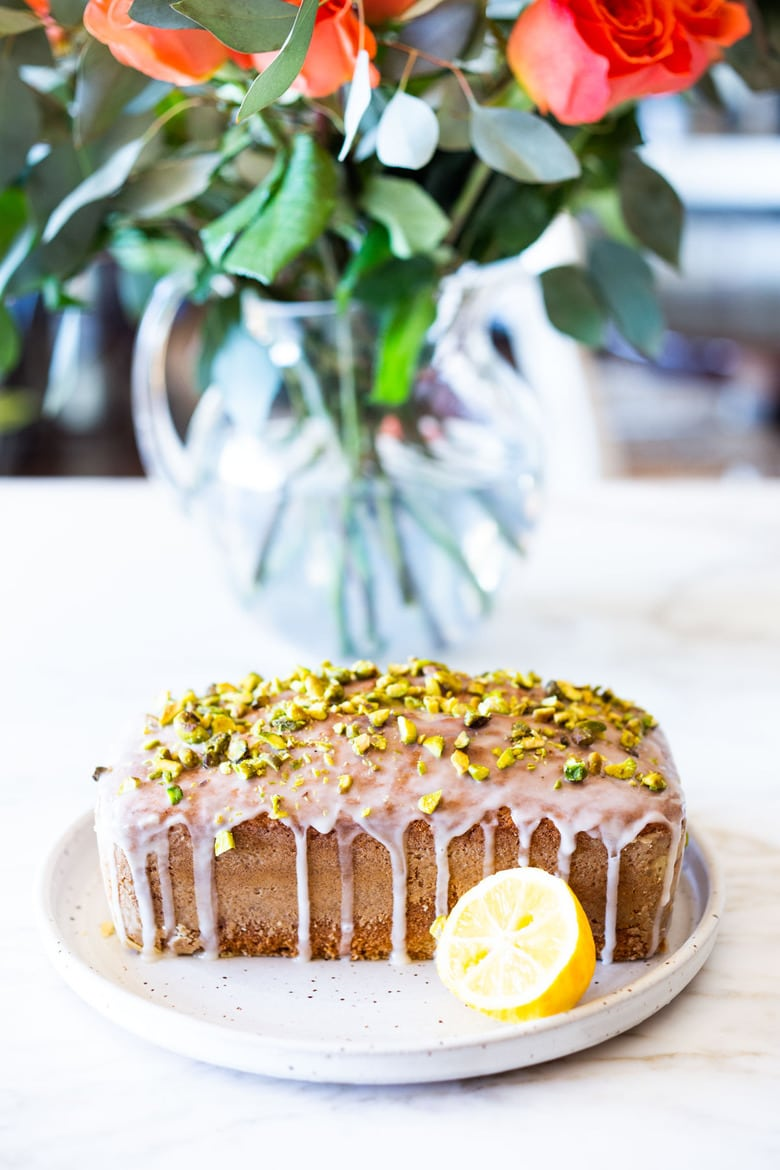 Meyer Lemon Loaf Cake with Toasted Pistachios and Lemony Glaze. The perfect balance between tart and sweet. #lemonloaf