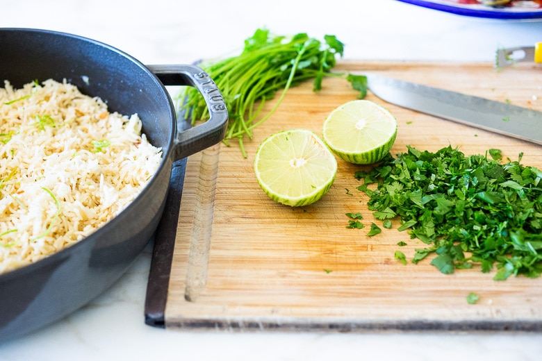 adding cilantro and lime to the rice