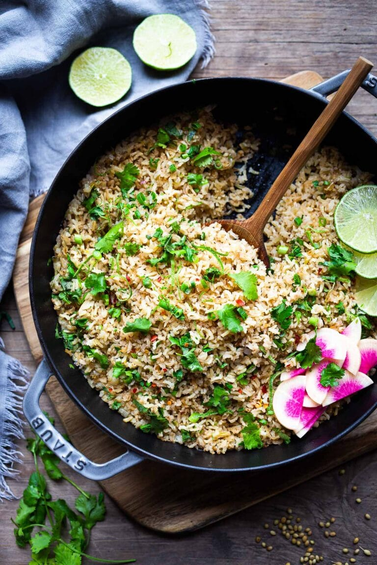 An easy healthy recipe for Cilantro Lime Rice that is made on the stovetop. Make this with brown or white basmati rice ( or jasmine!). #rice #cilantrolimerice #mexicanrice