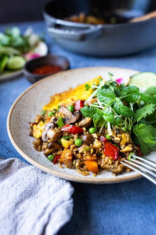 Nasi Goreng (Indonesian Fried Rice) loaded up with fresh veggies! Add egg or keep it vegan! Easy Tasty recipe! #nasigoreng