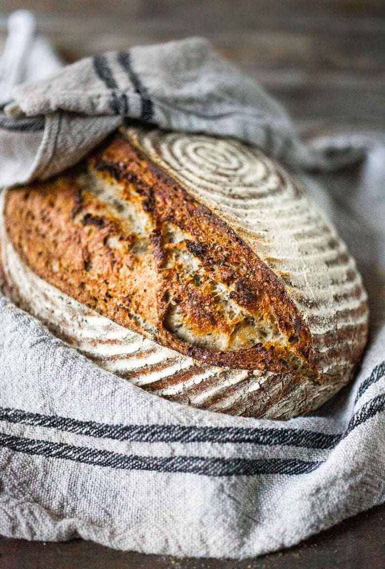 An EASY recipe for No Knead Sourdough Bread that rises overnight and is baked in the morning. #sourdough