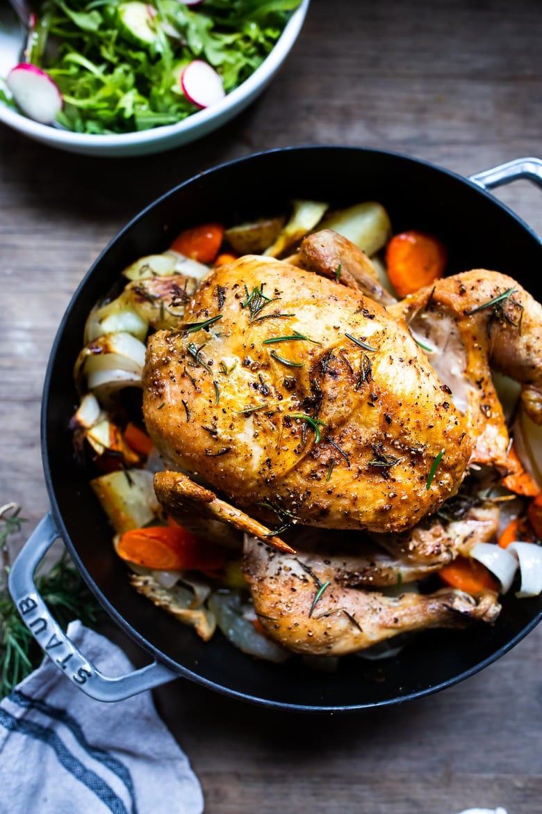 30 Fall Dinner Ideas! A simple easy recipe for roast chicken with lemon, garlic and rosemary, baked in the oven over vegetables. A delicious dinner recipe! #roastchicken