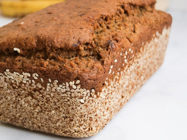 This Vegan Banana bread is not only healthy, it's made with sourdough starter or discard! Infused with ginger and sesame it is full of amazing flavor! #bananabread #veganbananabread #sourdough #yeastless
