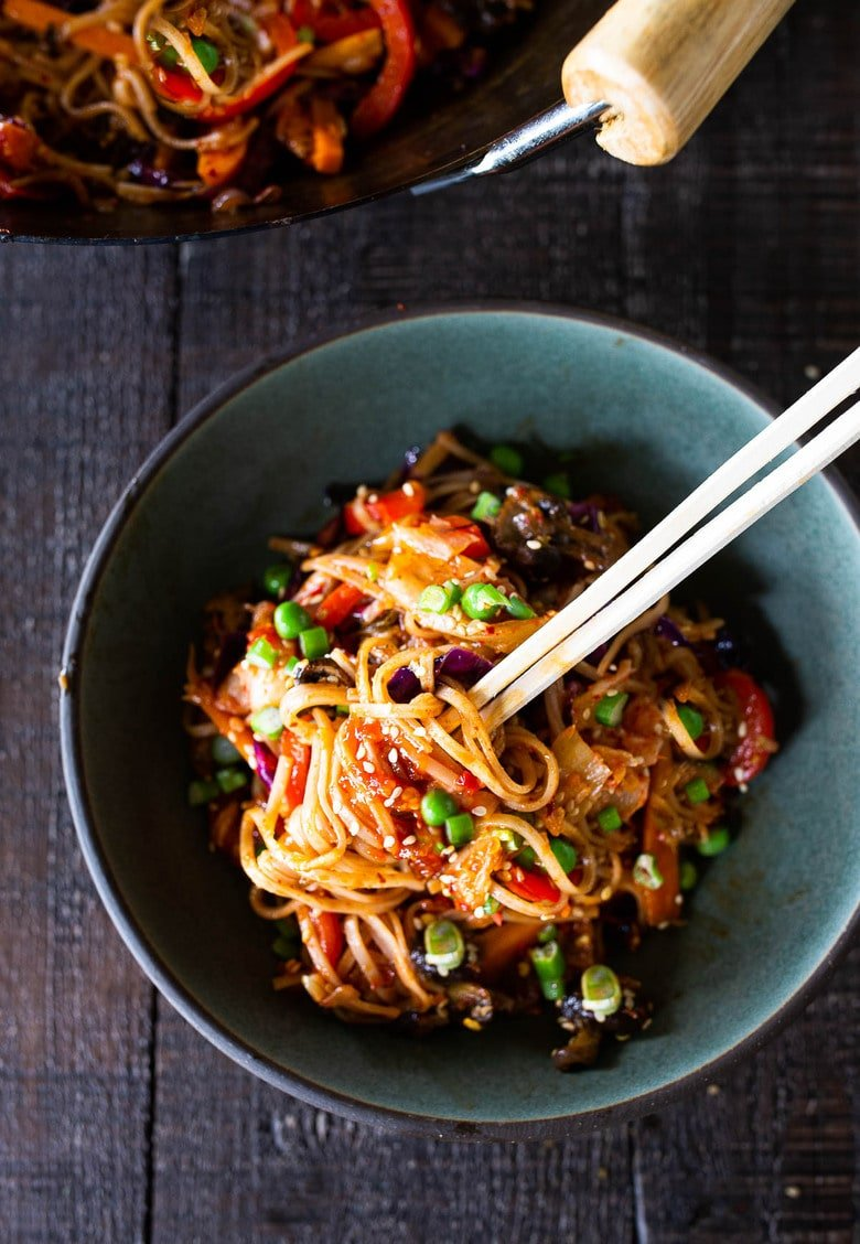 A flavorful recipe for Kimchi Noodles stir-fried with healthy veggies. Keep it vegan or add an egg, crispy tofu, chicken or shrimp!