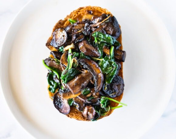 A simple healthy vegan recipe for Mushroom Toast with Garlic, Thyme and lemon zest. Serve it as a meal with a haearty salad, or top it with an egg for breakfast. A great way to use up sourdough bread! #mushroomtoast