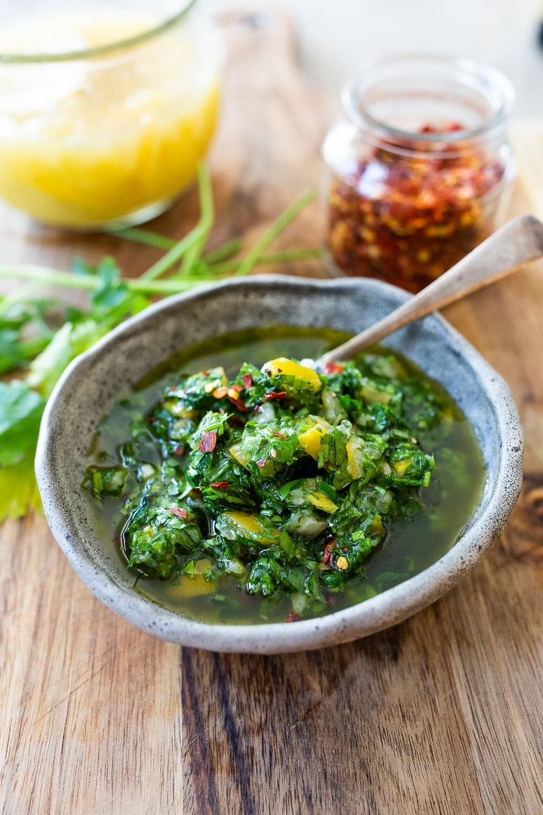This herby green sauce is made with Preserved Lemons- flavorful and robust it is great on grilled meat and fish and tossed in salads!