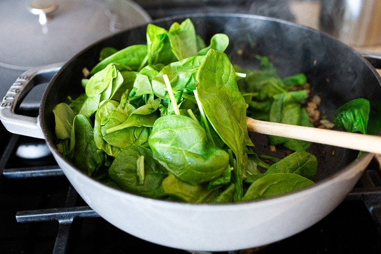 add spinach to the pan and wilt it