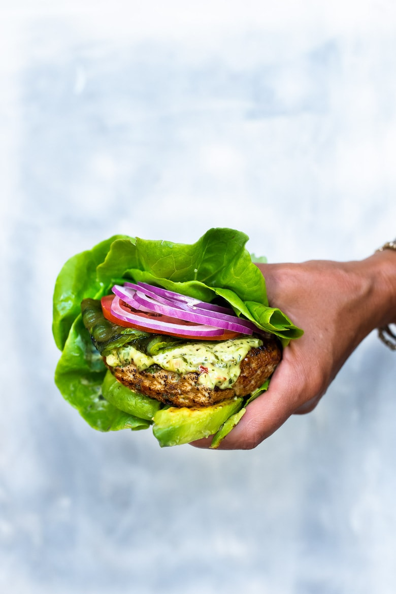 The best Turkey Burger Recipe with jalapeño, cilantro, lime zest, scallions , roasted poblano peppers and Chimichurri Mayo! Serve it in a bun or in a lettuce wrap! #turkeyburger #turkeyburgerrecipe