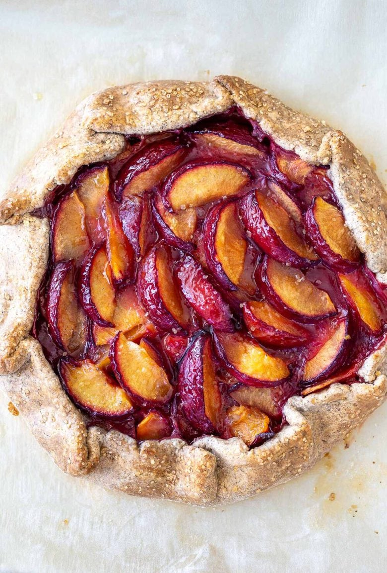 Juicy summer plums are highlighted in this simple recipe for Plum Galette with Buckwheat Crust. The buckwheat is super tasty - but optional here, so don't let it stop you! A pinch of five-spice adds a whisper of the exotic. #plumgalette #plumtart