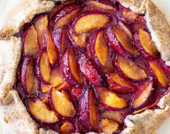 Juicy summer plums are highlighted in this simple recipe for Plum Galette with Buckwheat Crust. The buckwheat is super tasty - but optional here, so don't let it stop you! A pinch of five-spice adds a whisper of the exotic.#plumgalette #plumtart