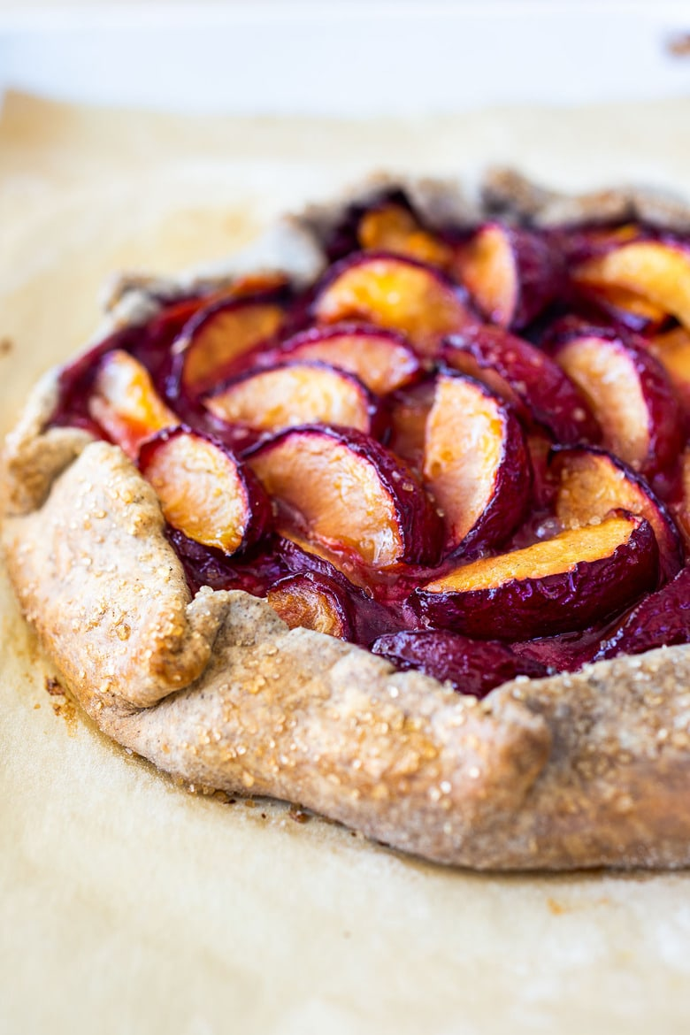 Plum Galette with juicy summer plums and a Buckwheat Crust. The buckwheat is super tasty - but optional here, so don't let it stop you! A pinch of five-spice adds a whisper of the exotic. #plumgalette #plumtart