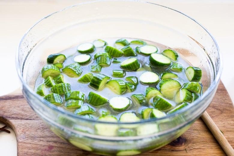 salting cucumbers in salt water