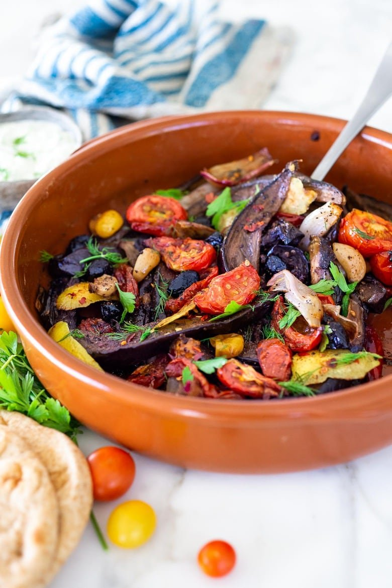 Slow-Baked Moroccan Eggplant with Ras el Hanout, caramelized garlic, shallots and tomatoes. A rustic side dish that can be turned into a hearty vegetarian main.  Serve with Basmati Rice or homemade Pita, and Tzatziki Sauce. #eggplant #veganrecipe #vegetariandinner