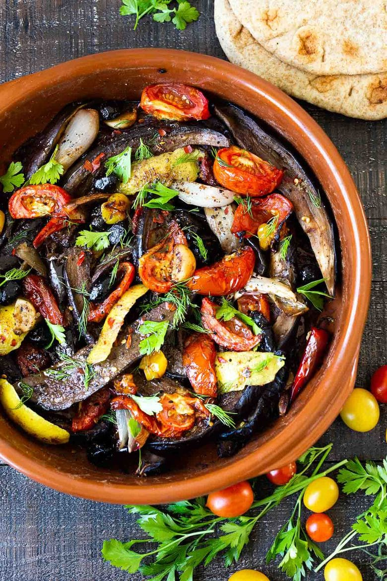 Slow-Baked Moroccan Eggplant with Ras el Hanout, caramelized garlic, shallots and tomatoes. A rustic side dish that can be turned into a hearty vegetarian main.  Serve with Basmati Rice or homemade Pita, and Tzatziki Sauce. #eggplant #vegetariandinner
