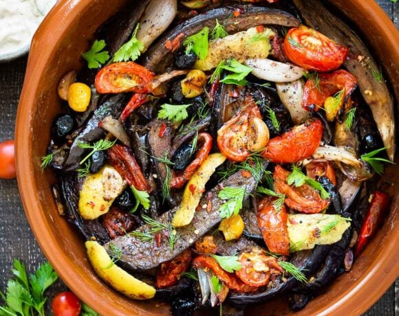 Slow-Baked Moroccan Eggplant with Ras el Hanout, caramelized garlic, shallots and tomatoes. A rustic side dish that can be turned into a hearty vegetarian main. Serve with Basmati Rice or homemade Pita, and Tzatziki Sauce.#eggplant #vegetariandinner