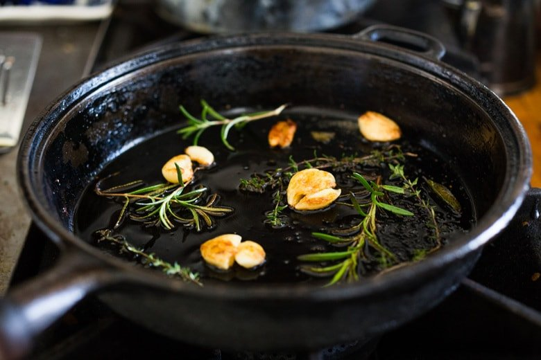 infuse the oil with garlic and herbs