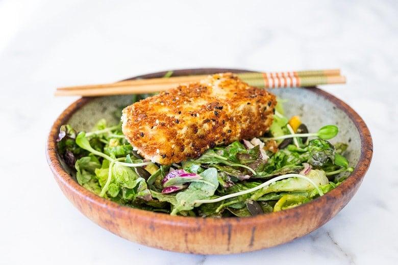 Tofu Katsu in a bowl over a salad