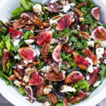 Fig and Arugula Salad with pecans, basil and goat cheese, tossed in a balsamic vinaigrette