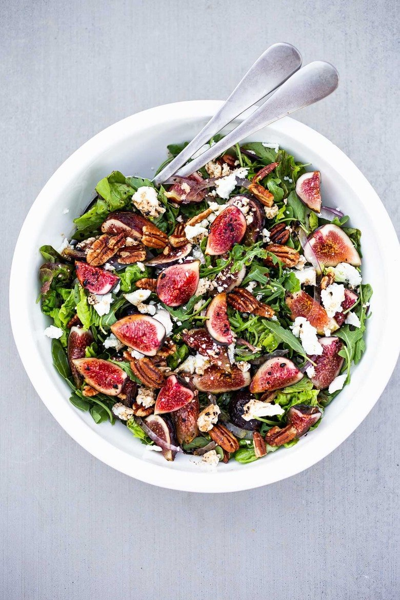 Here's one of our all-time favorite summer salads- Fig and Arugula Salad with Goat Cheese, Pecans and Basil tossed in a simple Balsamic Vinaigrette. #figsalad #figarugulasalad